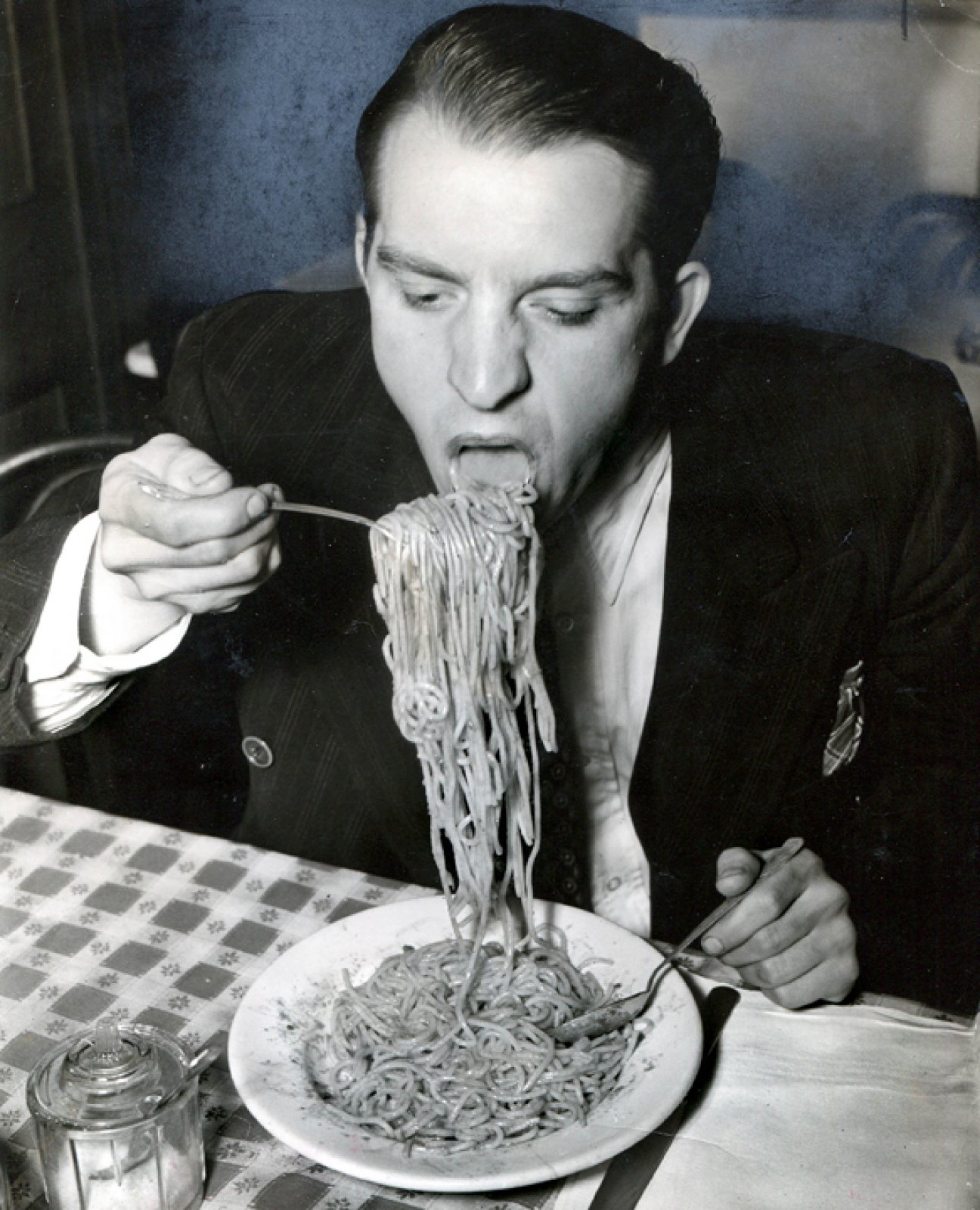 Phillip J. Stazzone is on WPA and Enjoys His Favorite Food as He's Heard That the Army Doesn't Go in Very Strong for Serving Spaghetti, 1940 © Weegee  / International Center of Photography, Courtesy of Ira and Suzanne Richer