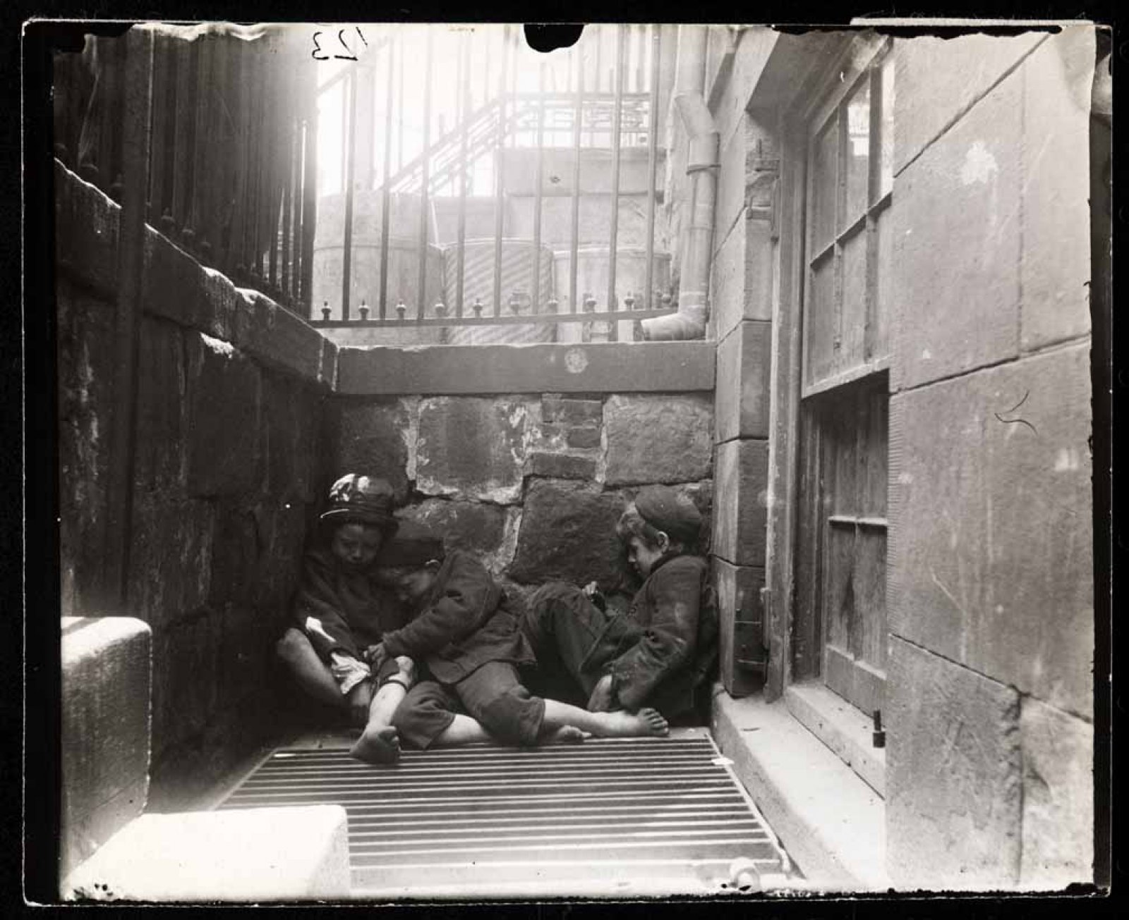Street Arabs in sleeping quarters, 1888-1889 / Jacob Riis / Museum of the City of New York